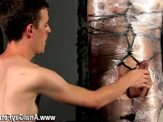 Hot attractive boy scene Cristian is almost swaying, wrapped up in wire and