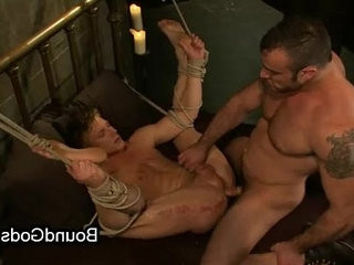Bound queer giving hot butt-cheeks to his partner and getranssexual fucked from him in sofa