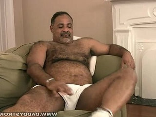 Stocky daddy plays with dick
