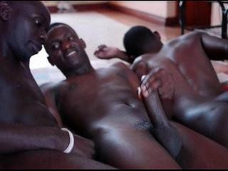 Three black african slightly-muscular gays jism together